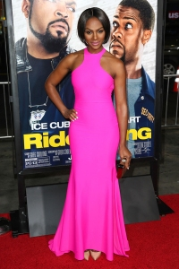 Looking absolutely gorgeous in a hot pink Michael Costello gown